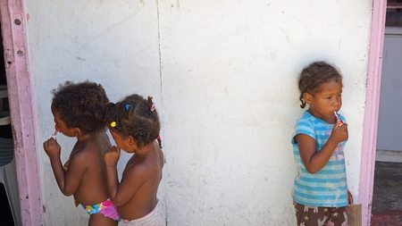 dominican republic 2017, small children collecting sweets from tourists Editorial