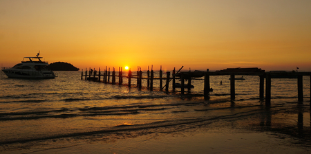 wooden jetty on otre beach at the sunset Stock Photo
