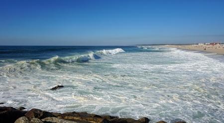 heavy waves in fouradouro beach during autumn Standard-Bild - 114258419