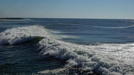 heavy waves in fouradouro beach during autumn Standard-Bild - 114258420