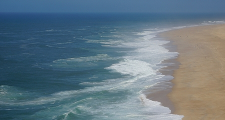 shore line of small tourist village nazare in portugal Standard-Bild - 114258394