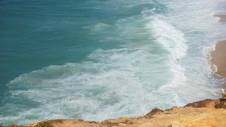 shore line of small tourist village nazare in portugal Standard-Bild - 114258396