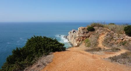 small lighthouse near portuguese city of nazare Standard-Bild - 114258397