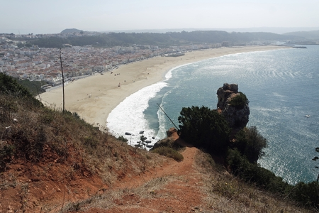 shore line of small tourist village nazare in portugal Standard-Bild - 114258398
