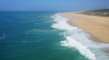 shore line of small tourist village nazare in portugal