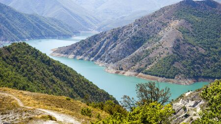 colorful kozjak lake in the mountains of northern macedonia Foto de archivo
