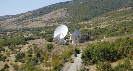 huge radio antennas in the landcape of macedonia