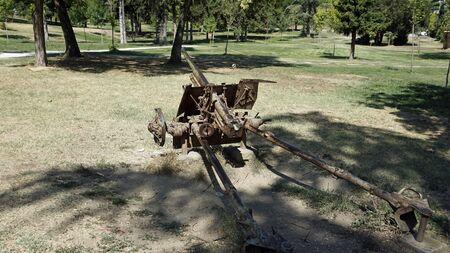 old rusty cannon in a public park in skopje 스톡 콘텐츠