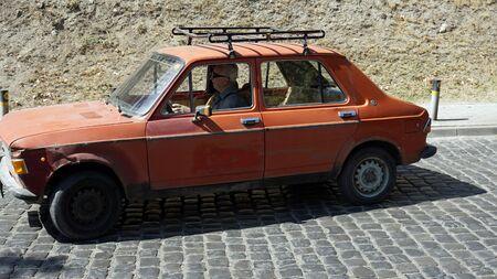 Skopje, circa September 2020: Old Man in rotten car