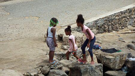 santa maria, cape verde, circa june 2018: young girls playing at the coast