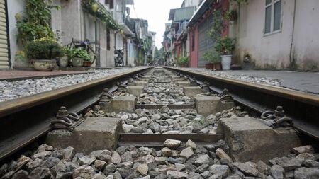 rusty railroad tracks in hanois famous train street