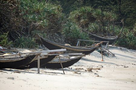 rotten fisher boats at the beach of hue
