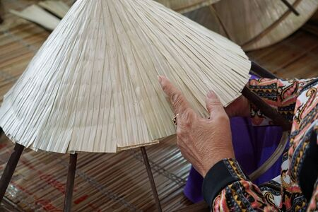 manufacture of traditional vietnamese bamboo huts in vietnam