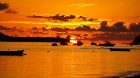 amazing red and orange sky at a sunset on the seychelles islands