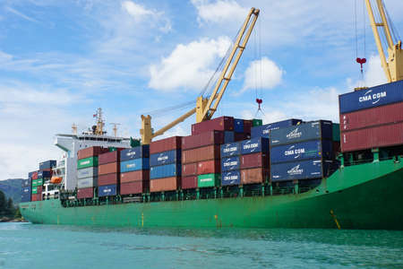 Mahe, Seychelles - circa January 2015: freight ship in the Harbor