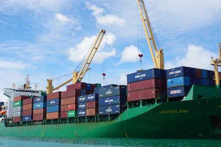 Mahe, Seychelles - circa January 2015: freight ship in the Harbor Stockfoto - 148100351