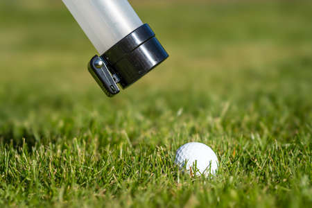 Ball tube picking up golf ball
