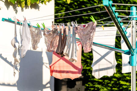 Drying Clothes on a rotary clothes dryer.