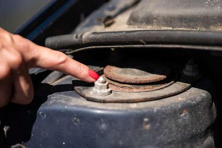 A woman shows a rusty strut bearing.
