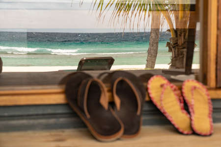Two pairs of Flip Flops on a porch at the Maledives. Standard-Bild