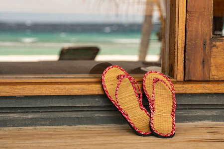 A pair of Flip Flops on a porch at the Maledives.