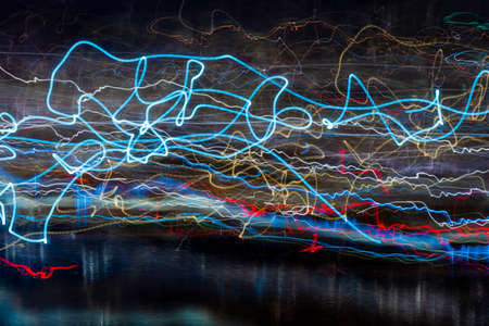 Neon city lights in a long exposure. Standard-Bild