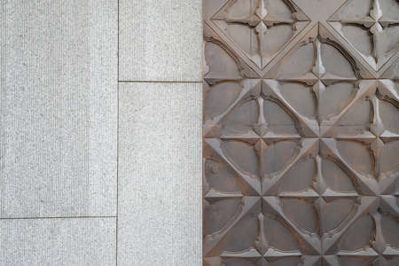 contemporary pattern on wooden door and stone wall photo