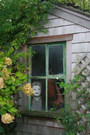 Spooky cottage window in Nantucket.  Stock Photo