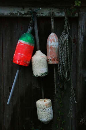 buoys: Buoys and rope on fence in Nantucket.