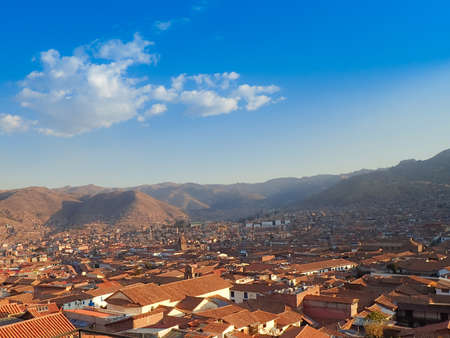 Aerial view of the red tiled roofs of buildings in Cusco, Peru Stock Photo