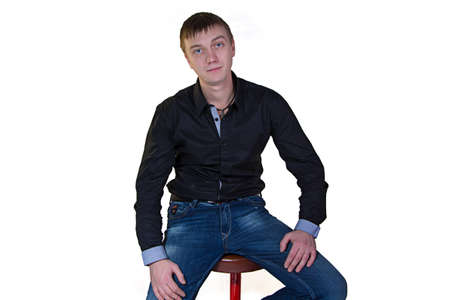 Man in black shirt sitting on the chair photo
