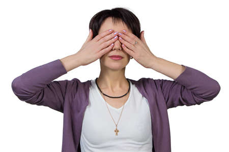 Woman covering her eyes with her hands - isolated photo portrait