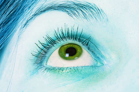 side viewing: Green eye - photo of a green eye and blue skin