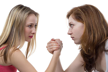battle of the sexes: Arm wrestling - isolated photo portrait of girls