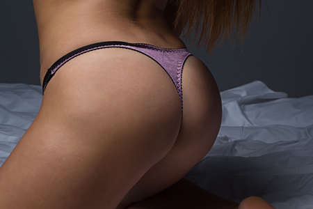 Soft Feminine Form - photo of female buttocks photo