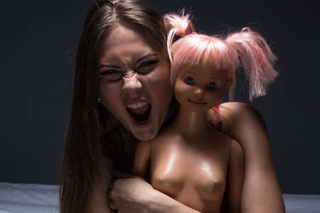 Woman holding a doll photo