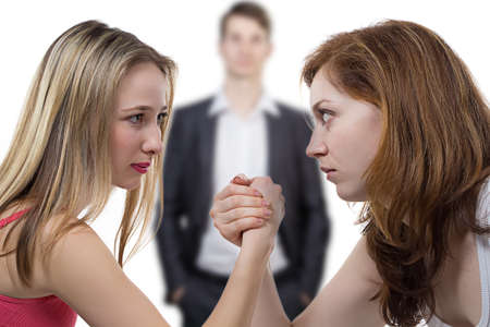 battle of the sexes: Arm wrestling - photo portrait of girls fighting for man