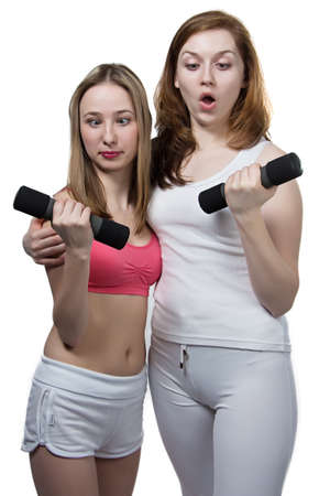 Two girls do fitness - isolated photo portrait