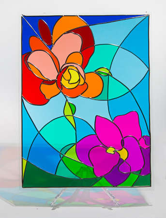 Photo of hand made stained glass with shadow Standard-Bild