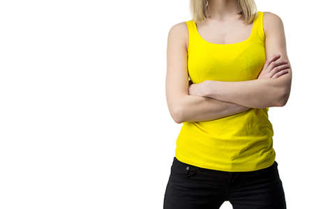 Woman in yellow T-shirt with arms crossed - isolated photo photo