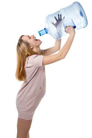Pregnant woman drinking from bottle  photo