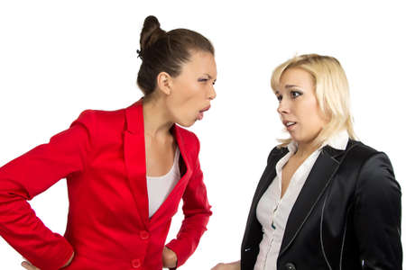 conflicted: Two conflicted business women on the white background Stock Photo