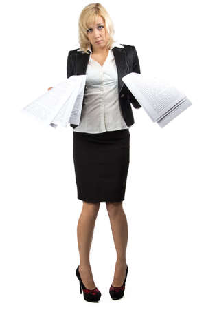 Desperate businesslady with a pile of papers Standard-Bild