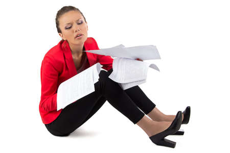 thoroughly: Business woman sitting on the floor with a pile of papers Stock Photo