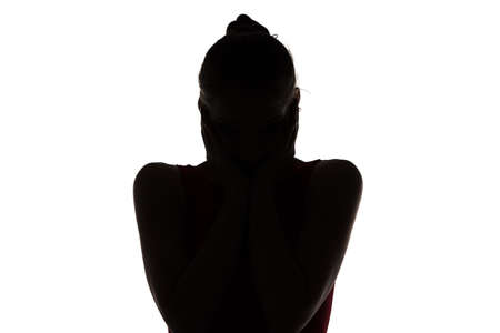 Silhouette of surprised girl on white background photo