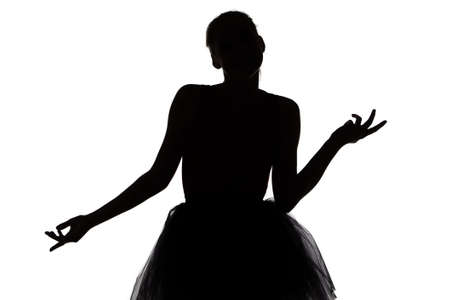 Young dancer girl thinking about something on white background photo