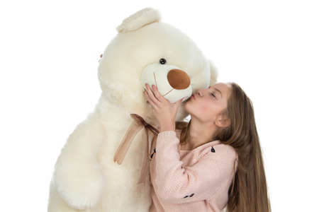 Image of happy teenage girl with teddy bear on white background photo