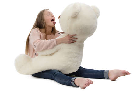 blessedness: Photo of naughty teenage girl with teddy bear on white background