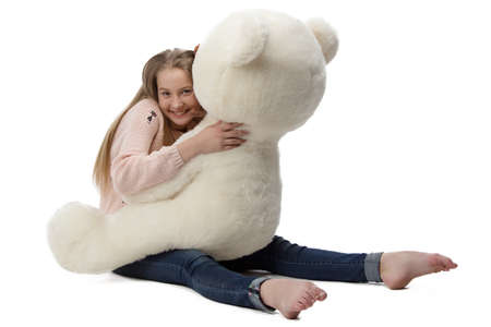 blessedness: Portrait of girl hugging teddy bear on white background Stock Photo