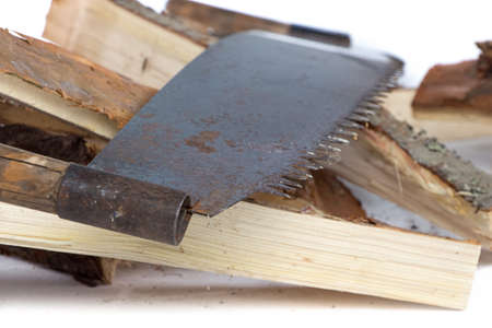 Image of handsaw and birch woods on white background photo